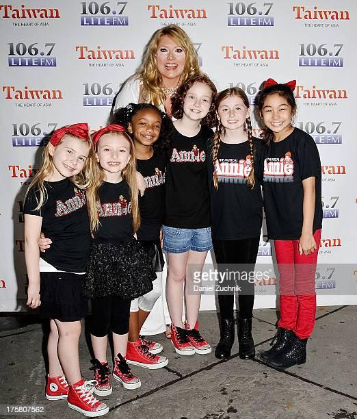 Brooklyn Shuck Emily Rosenfeld Tyrah Skye Odoms Delilah Taylor Richardson Gaby Bradbury and Amaya Braganza from the cast of 'Annie' attend 1067 LITE...