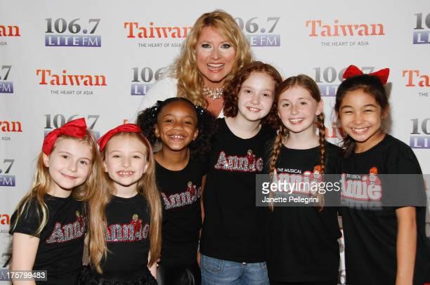 Brooklyn Shuck Emily Rosenfeld Tyrah Skye Odoms Taylor Richardson Gaby Bradbury and Amaya Braganza from the cast of Annie with 1067 LITE FM's host...