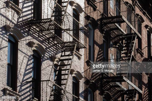 Brooklyn style apartments with fire stairs on exterior of building in New York on March 1 2017