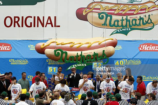 Competetors are seen during the annual International July Fourth Hot Dog Eating Contest 04 July 2007 at the original Nathans Famous restaurant in the...