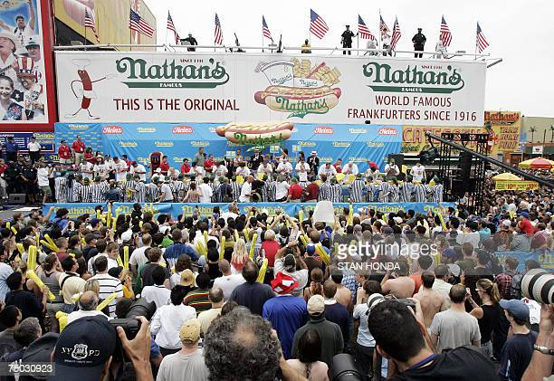 Contestants compete during the annual International July Fourth Hot Dog Eating Contest 04 July 2007 at the original Nathans Famous restaurant in the...