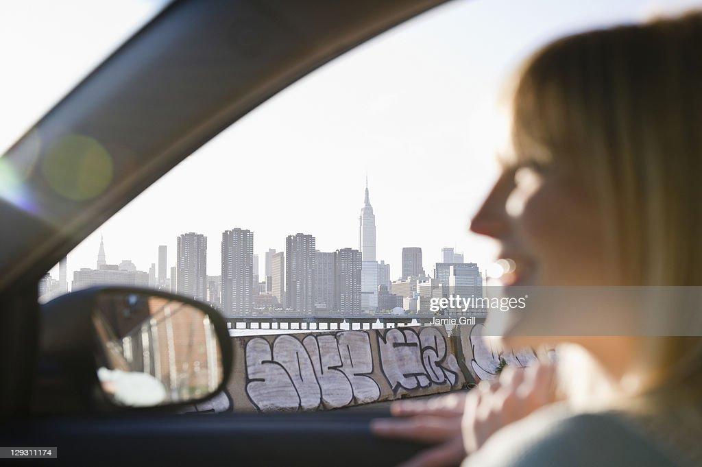 USA, Brooklyn, Williamsburg, Woman driving through city : Stock Photo