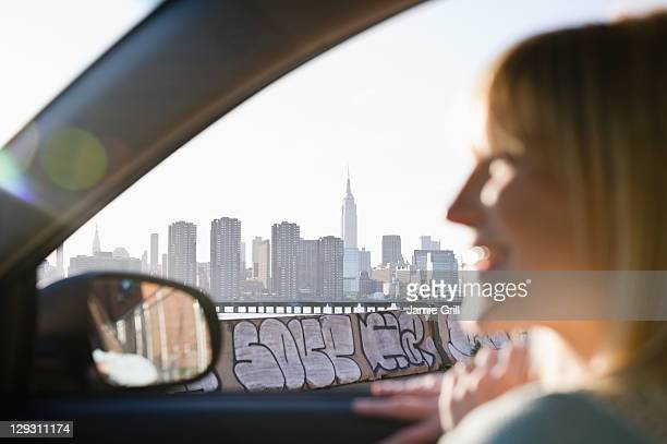 USA, Brooklyn, Williamsburg, Woman driving through city
