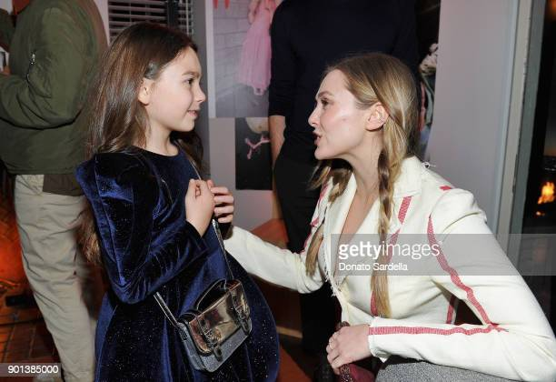 Brooklynn Prince and Elizabeth Olsen attend W Magazine's Celebration of its 'Best Performances' Portfolio and the Golden Globes with Audi Dior and...