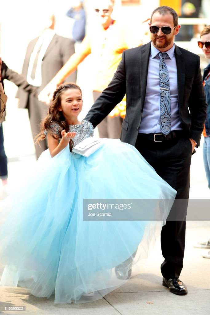 Brooklynn Prince (L) and guest attend 'The Florida Project' premiere during the 2017 Toronto International Film Festival at Ryerson Theatre on September 10, 2017 in Toronto, Canada.