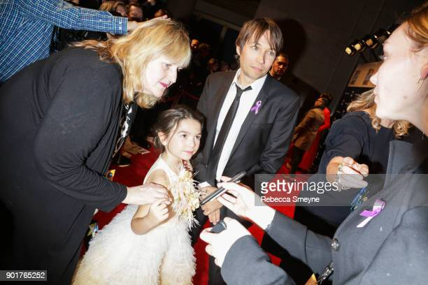 Brooklynn Prince and Sean Baker do interviews on the red carpet at the 2017 IFP Gotham Awards at Cipriani Wall Street on November 27 2017 in New York...