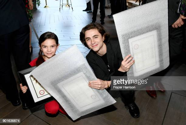 Brooklynn Prince and Timothee Chalamet pose with awards during 18th Annual AFI Awards at Four Seasons Hotel Los Angeles at Beverly Hills on January 5...