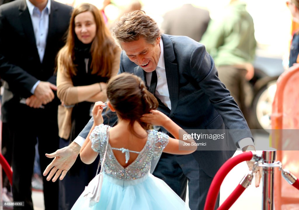 Brooklynn Prince (L) and Willem Dafoe attend 'The Florida Project' premiere during the 2017 Toronto International Film Festival at Ryerson Theatre on September 10, 2017 in Toronto, Canada.