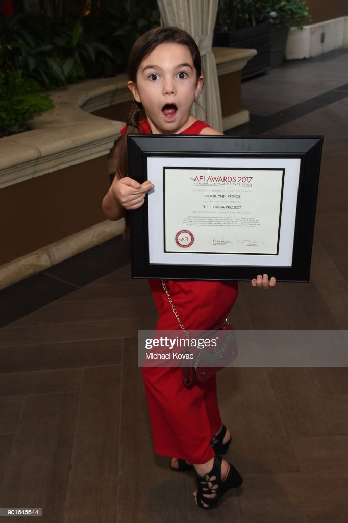 Brooklynn Prince holds her award during the 18th Annual AFI Awards at Four Seasons Hotel Los Angeles at Beverly Hills on January 5, 2018 in Los Angeles, California.