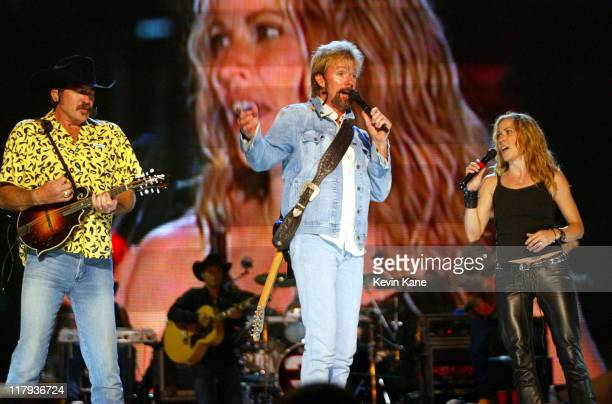 Brooks and Dunn with Sheryl Crow during Dale EarnhardtTribute Concert at Daytona International Speedway in Daytona Beach Florida United States