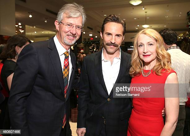 Brooks Brothers CEO Claudio Del Vecchio actor Alessandro Nivola and actress Patricia Clarkson attend as BROOKS BROTHERS Celebrates The Holidays With...