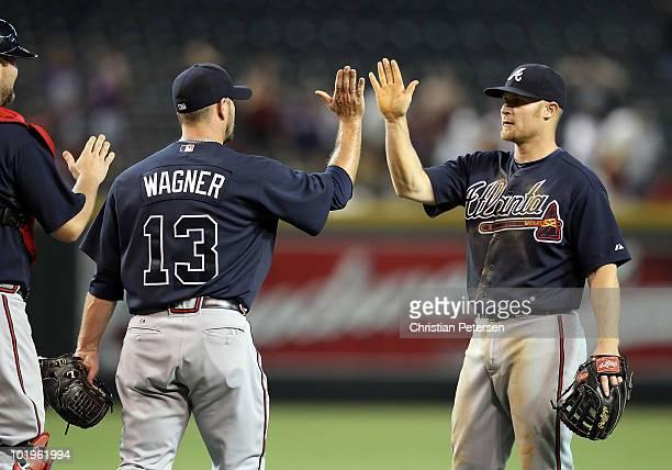 Brooks Conrad of the Atlanta Braves highfives teammate Billy Wagner after defeating the Arizona Diamondbacks in the Major League Baseball game at...