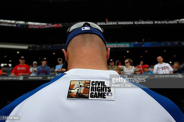 Brooks Conrad of the Atlanta Braves signs autographs prior to the MLB Civil Rights game against the Philadelphia Phillies at Turner Field on May 15...
