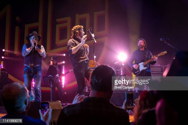 Brooks Dunn perform alongisde Mark Wystrach of Midland at the Ryman Auditorium on May 5 2019 in Nashville Tennessee