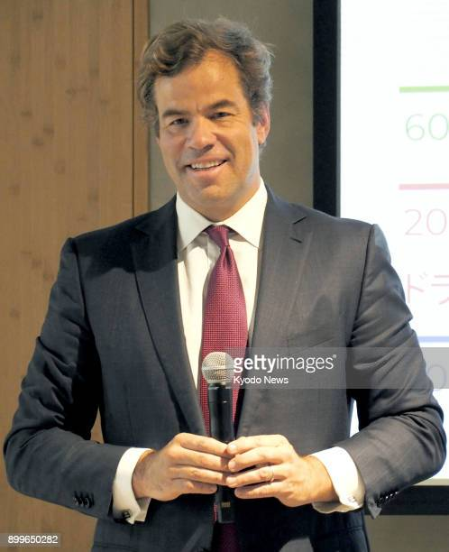Brooks Entwistle a senior official of Uber Technologies Inc speaks to reporters in Tokyo on Nov 27 2017 Japan's SoftBank Group Corp has agreed with...