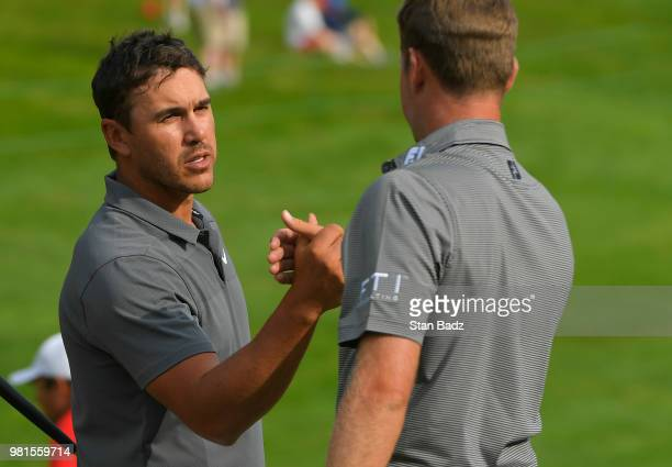Brooks Koepka and Webb Simpson shakes hands on the 18th hole during the second round of the Travelers Championship at TPC River Highlands on June 22...