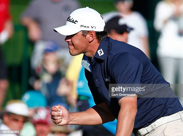 Brooks Koepka celebrates after winning the Waste Management Phoenix Open a score of 15 underpar at TPC Scottsdale on February 1 2015 in Scottsdale...