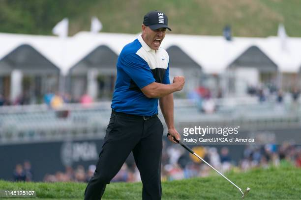 Brooks Koepka celebrates his victory on the 18th hole during the final round of the 101st PGA Championship held at Bethpage Black Golf Course on May...