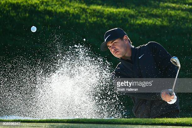 Brooks Koepka hits out of the bunker on the 12th hole during the second round of the Waste Management Phoenix Open at TPC Scottsdale on February 5...