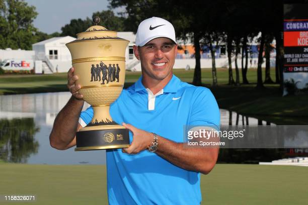 Brooks Koepka holds the Gary Player Cup after the final round of the World Golf Championships - FedEx St. Jude Invitational on July 28, 2019 in...