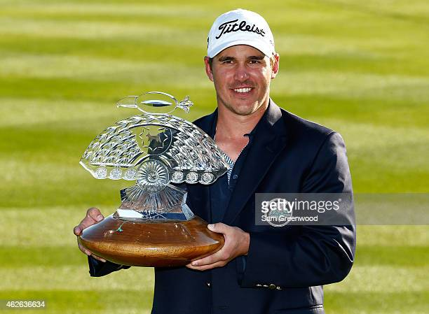 Brooks Koepka holds the trophy after winning the Waste Management Phoenix Open at TPC Scottsdale on February 1 2015 in Scottsdale Arizona