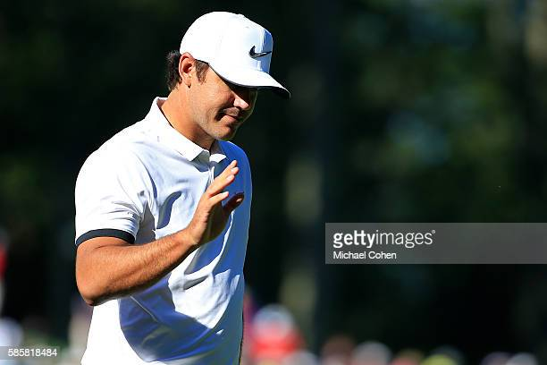 Brooks Koepka makes a birdie putt on the 11th hole during the first round of the Travelers Championship at TPC River Highlands on August 4 2016 in...