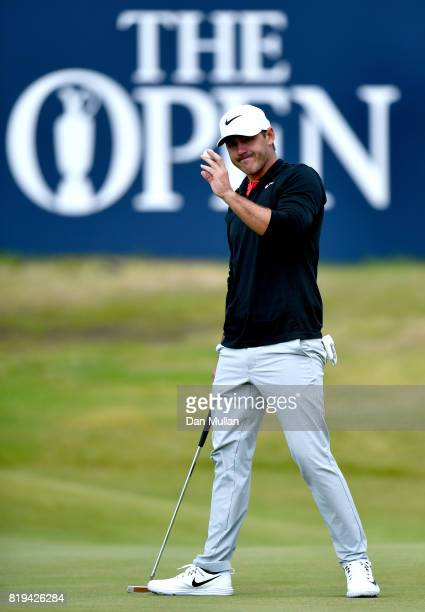 Brooks Koepka of the United States acknowledges the crowd on the 18th hole during the first round of the 146th Open Championship at Royal Birkdale on...