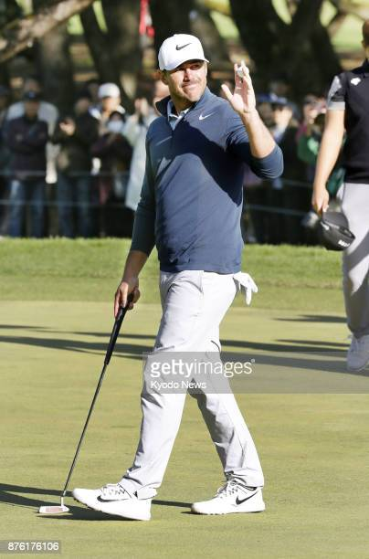 Brooks Koepka of the United States acknowledges the gallery after holing his putt on the 18th to close out the Dunlop Phoenix golf tournament at...