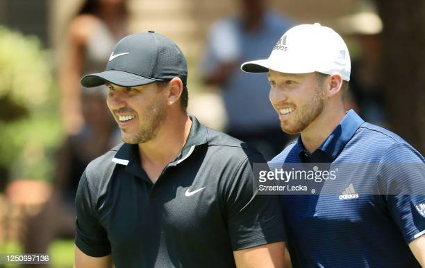 Brooks Koepka of the United States and Daniel Berger of the United States reacts during the second round of the RBC Heritage on June 19 2020 at...