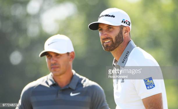 Brooks Koepka of the United States and Dustin Johnson of the United States look on from the ninth tee during the final round of the 2018 US Open at...
