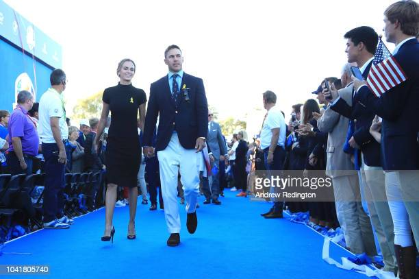 Brooks Koepka of the United States and girlfriend Jena Sims depart the opening ceremony for the 2018 Ryder Cup at Le Golf National on September 27...