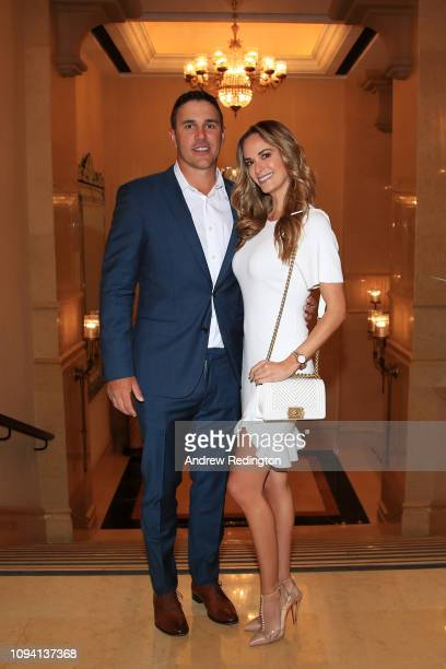 Brooks Koepka of the United States and girlfriend Jena Sims pose for a photo ahead of the Abu Dhabi HSBC Golf Championship at the Abu Dhabi Golf Club...