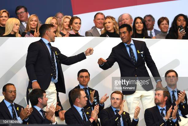 Brooks Koepka of the United States and Tony Finau of the United States react after being matched against Justin Rose of Europe and Jon Rahm of Europe...