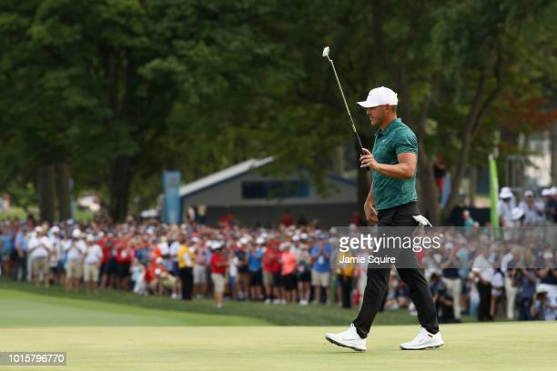 Brooks Koepka of the United States celebrates after making a par on the 18th green to win the 2018 PGA Championship with a score of 16 at Bellerive...