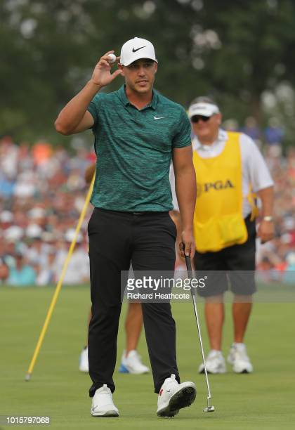 Brooks Koepka of the United States celebrates after making a par on the 18th green to win the 2018 PGA Championship with a score of -16 at Bellerive...