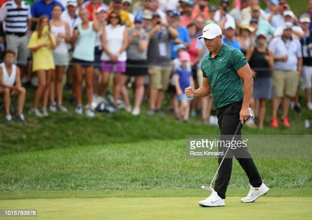 Brooks Koepka of the United States celebrates after making a putt for birdie on the 15th green during the final round of the 2018 PGA Championship at...
