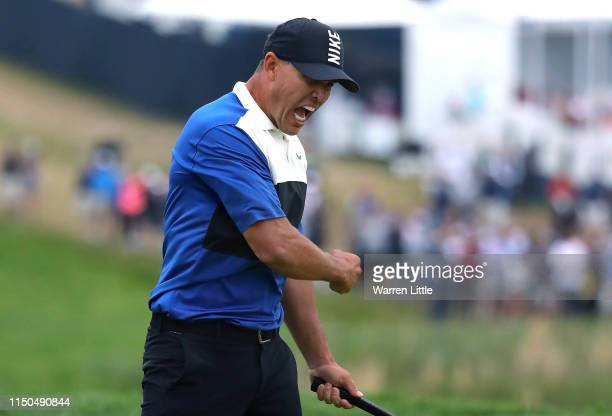 Brooks Koepka of the United States celebrates winning on the 18th green during the final round of the US PGA Championship at Bethpage Black Golf...