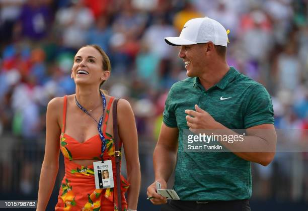 Brooks Koepka of the United States celebrates with his girlfriend Jena Sims after winning the 2018 PGA Championship with a score of 16 at Bellerive...