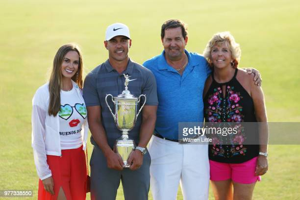 Brooks Koepka of the United States celebrates with the trophy and his father Robert Koepka girlfriend Jena Sims and mother Denise Jakows after...