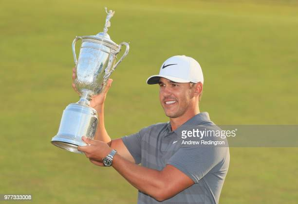 Brooks Koepka of the United States celebrates with the US Open Championship trophy after winning the 2018 US Open at Shinnecock Hills Golf Club on...