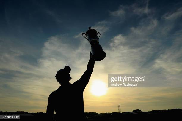 Brooks Koepka of the United States celebrates with the U.S. Open Championship trophy after winning the 2018 U.S. Open at Shinnecock Hills Golf Club...