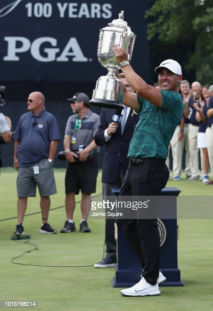 Brooks Koepka of the United States celebrates with the Wanamaker Trophy on the 18th green after winning the 2018 PGA Championship with a score of 16...