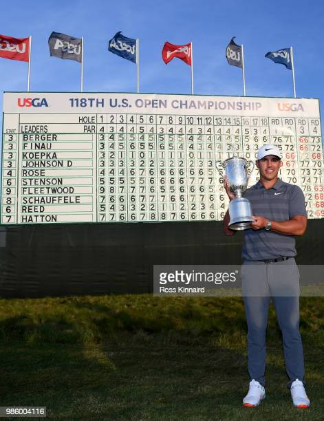 Brooks Koepka of the United States celebrates with the winners trophy after the final round of the 2018 US Open at Shinnecock Hills Golf Club on June...