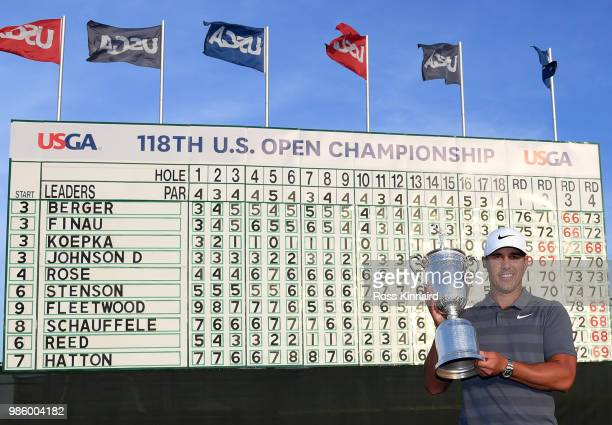 Brooks Koepka of the United States celebrates with the winners trophy after the final round of the 2018 U.S. Open at Shinnecock Hills Golf Club on...