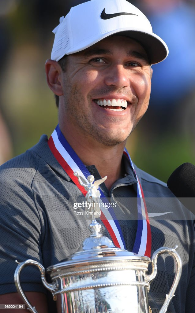 Brooks Koepka of the United States celebrates with the winners trophy after the final round of the 2018 U.S. Open at Shinnecock Hills Golf Club on June 17, 2018 in Southampton, New York.