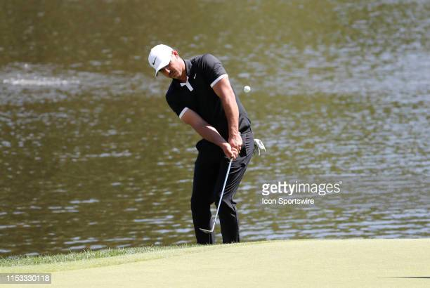 Brooks Koepka of the United States chips onto the 16th green during the Final Round of the Travelers Championship on June 23 2019 at TPC River...