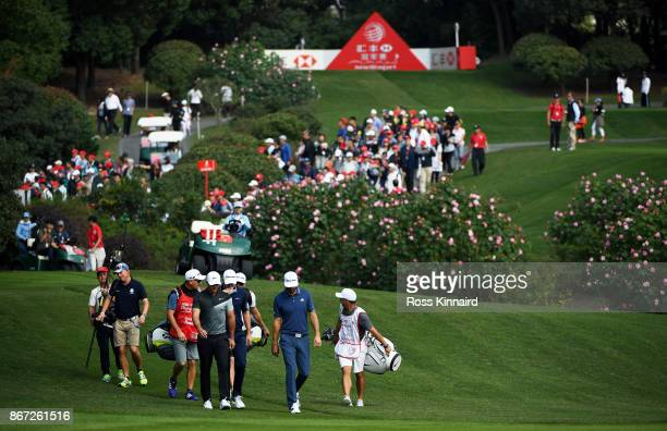 Brooks Koepka of the United States Dustin Johnson of the United States and Justin Rose of England walk on the second hole during the third round of...