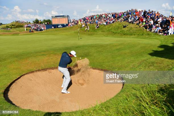 Brooks Koepka of the United States hits a bunker shot on the 7th hole during the third round of the 146th Open Championship at Royal Birkdale on July...