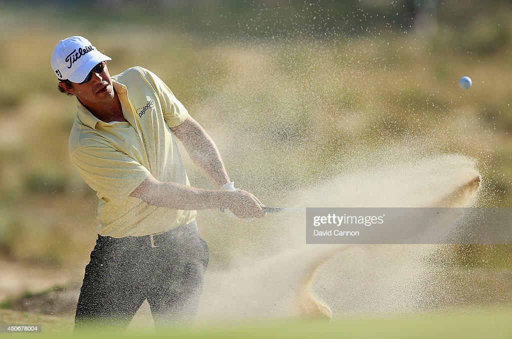 Brooks Koepka of the United States hits a shot from a greenside bunker on the 12th hole during the final round of the 114th U.S. Open at Pinehurst Resort & Country Club, Course No. 2 on June 15, 2014 in Pinehurst, North Carolina.