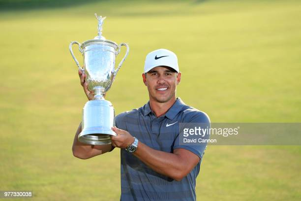 Brooks Koepka of the United States holds the trophy after his one shot victory during the final round of the 2018 US Open at Shinnecock Hills Golf...